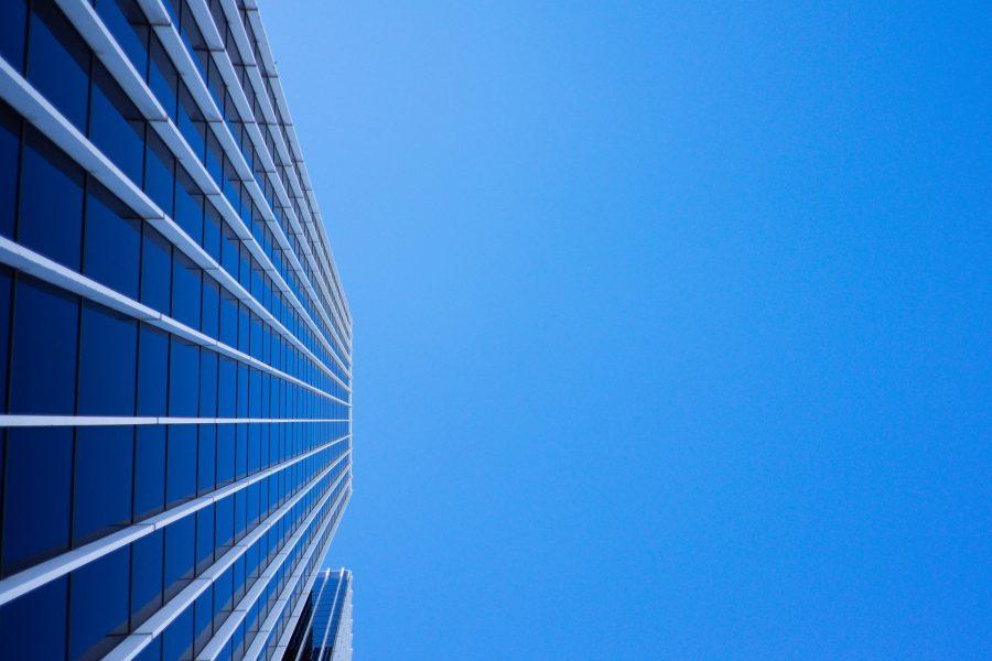 skyscraper against a royal blue sky