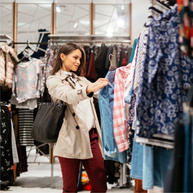 Beautiful woman shopping in a clothing store